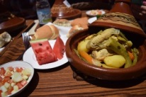 A typical lunch at Qalam: Chicken Tajine, salad, bread, and fruit.