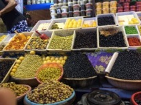 An assortment of olives and other pickled vegetables in a Moroccan souk (market)